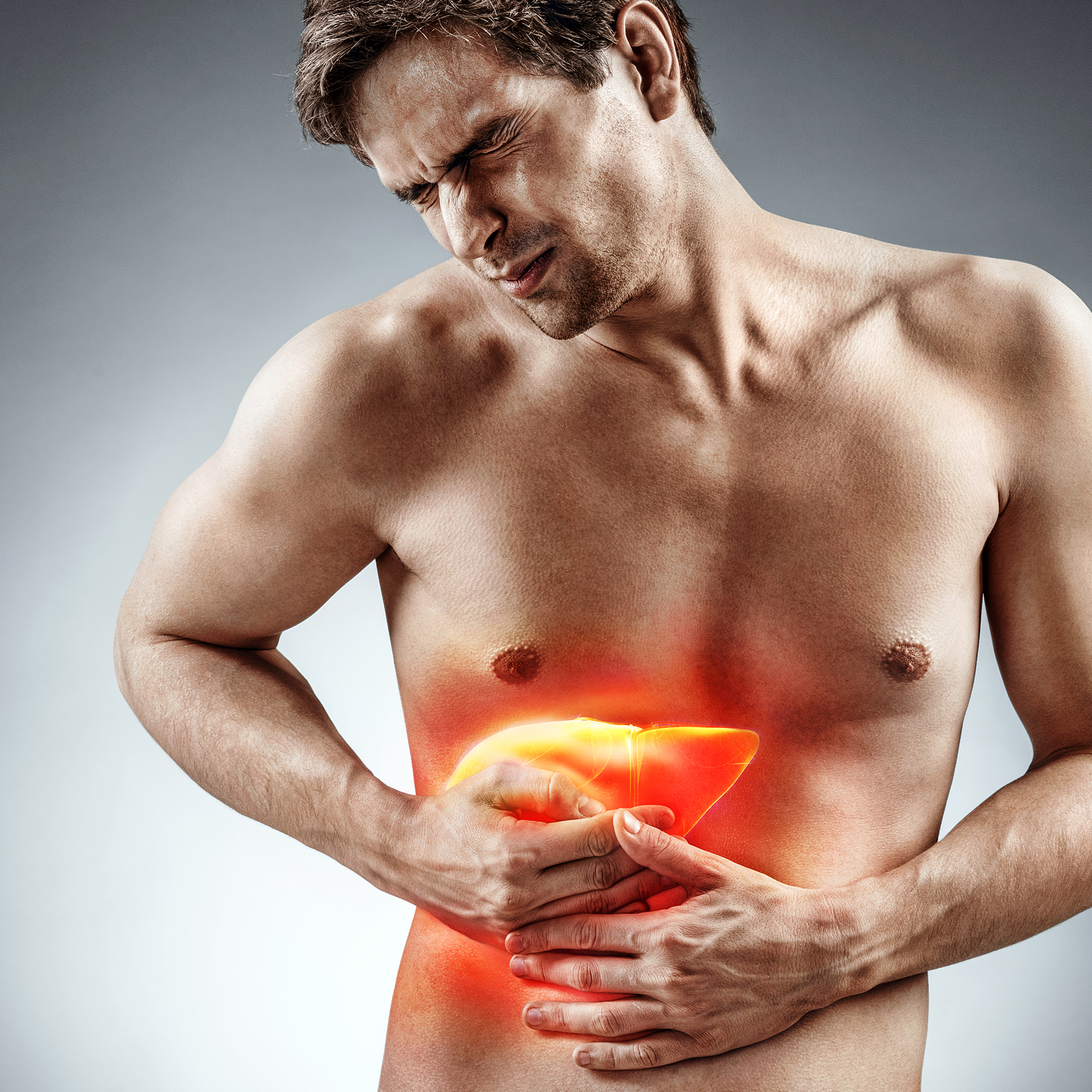 man holding liver pain